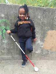 Young girl with her first white cane